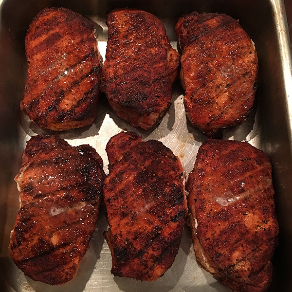 Once the chops reach 150 degrees, remove from grill and serve immediately.