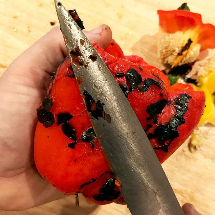 Removing excess char from smoked peppers is easy with a blunt knife.