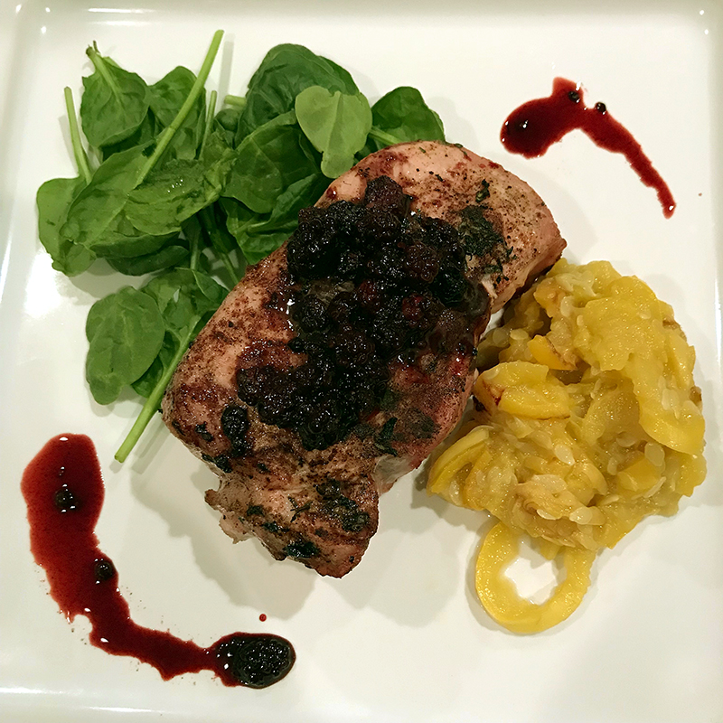 Place a chop in the center of the plate and top with Balsamic Blackberry Compote. This dish goes great with summer greens and stewed squash.