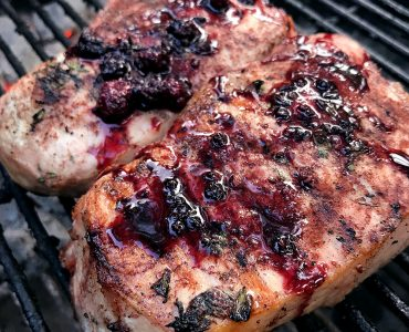 Pork chops with blackberry compote on the grill